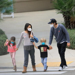 Ashton Kutcher and wife Mila Kunis wear their 'I Voted' stickers in LA